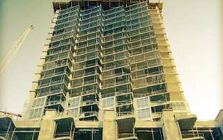Photo of tower under construction.